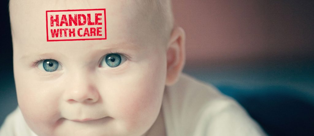 Photo of baby with handle with care sign