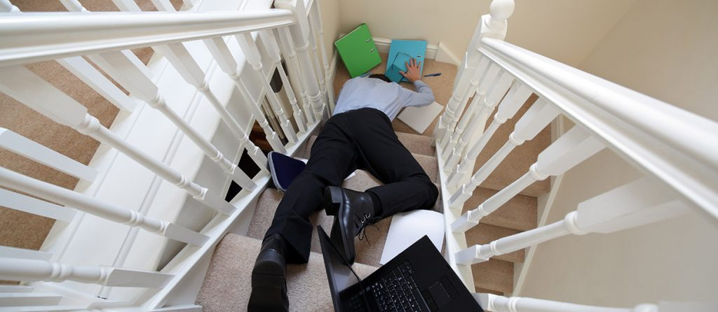 Picture of man falling down stairs
